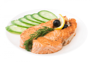appetizing-grilled-salmon-with-sliced-cucumber-lemon-and-black-5398408