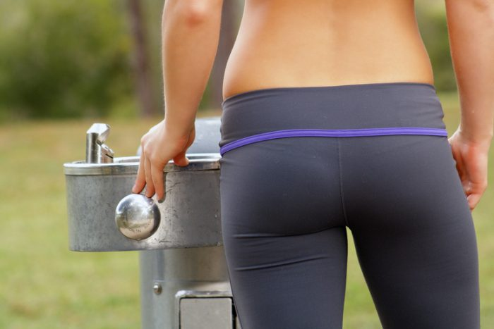 beautiful-female-athlete-at-a-water-fountain-2-4917302
