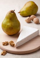 green-pears-cheese-brie-cores-of-walnuts-on-wooden-board-5244485